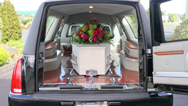 A hearse is a vehicle arranged for transporting the deceased